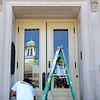 Owner of M & R Painting in Leominster Mike Pompeo paints the door to the Leominster Public Library on Tuesday afternoon. His company has been working on the building for the past several weeks. SENTINEL & ENTERPRISE/JOHN LOVE