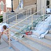 Owner of M & R Painting in Leominster Mike Pompeo paints the door to the Leominster Public Library as his employee Justin Tarbell of Fitchburg paints the rails on Tuesday afternoon. SENTINEL & ENTERPRISE/JOHN LOVE
