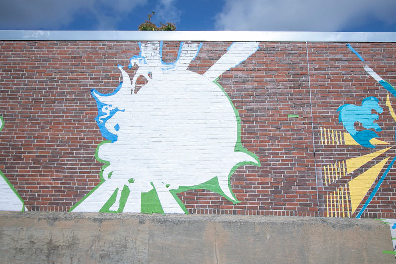 Artists Monique Guthrie and Erin Cregg got a Community Development Block grant from the City of Fitchburg to paint a mural on the back wall of the Fitchburg Public Library. On Monday Guthrie was painting the Greek god Poseidon and Cregg was painting the Greek god Athena. SENTINEL & ENTERPRISE/JOHN LOVE