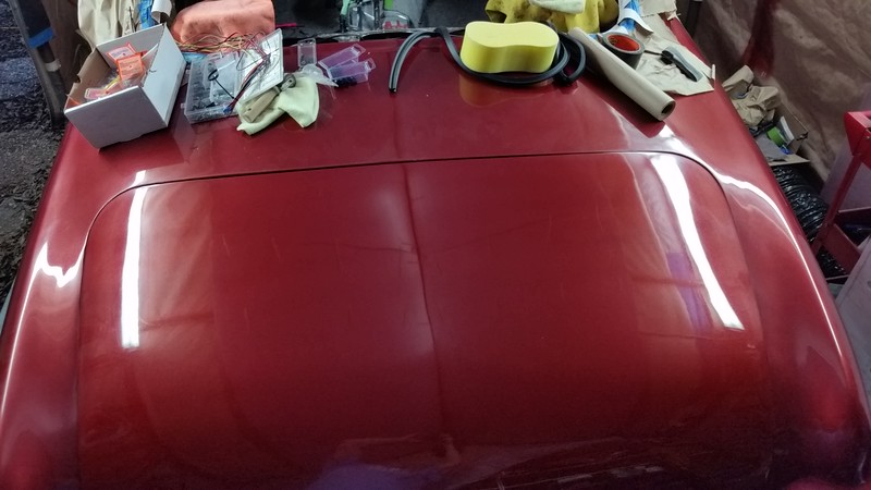 The lid was polished and waxed. The rest of the car has not been waxed yet, and you can surely tell it..