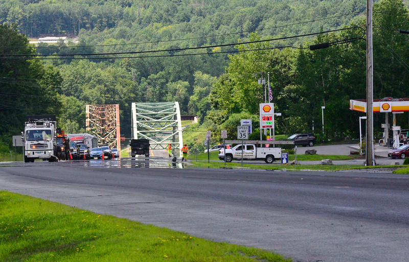 KRISTOPHER RADDER — BRATTLEBORO REFORMER<br /> Crews paint the lines on Route 9, in Chesterfield, N.H., on Thursday, July 30, 2020, which fully marked out the old passing lane between Jeremy Drive and Friedsam Drive.