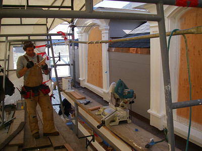 Carpentry repairs in progress. Note that he is priming all edges before installing.