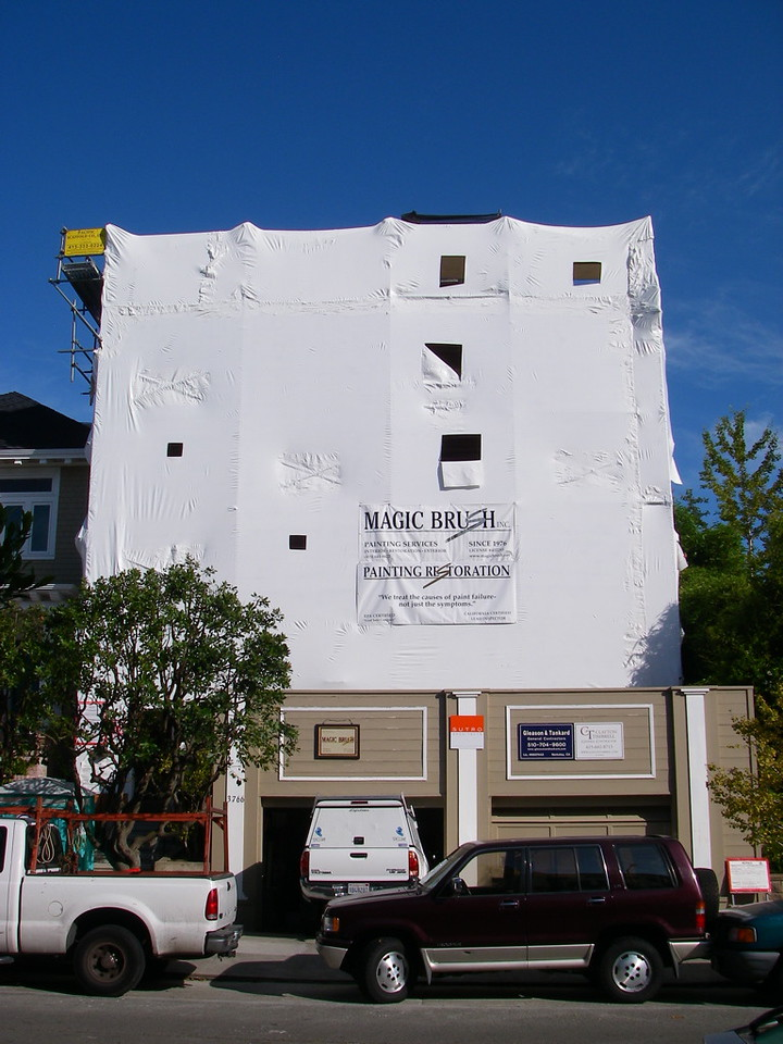"""""""Shrink-wrap"""" containment on scaffolding."""