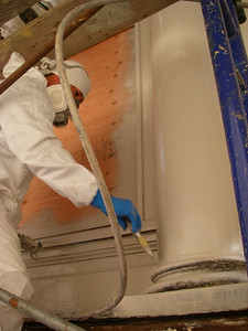 First coat of primer. Takes place after stripping, epoxy consolidating, and epoxy repairs.