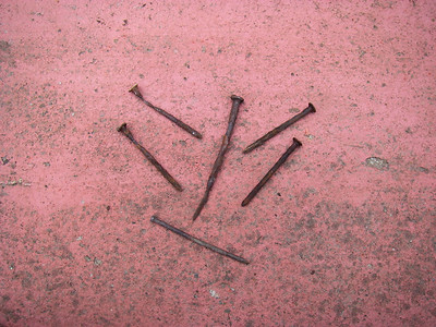 The usual suspects - old rusted nails that facilitate dry-rot pockets.