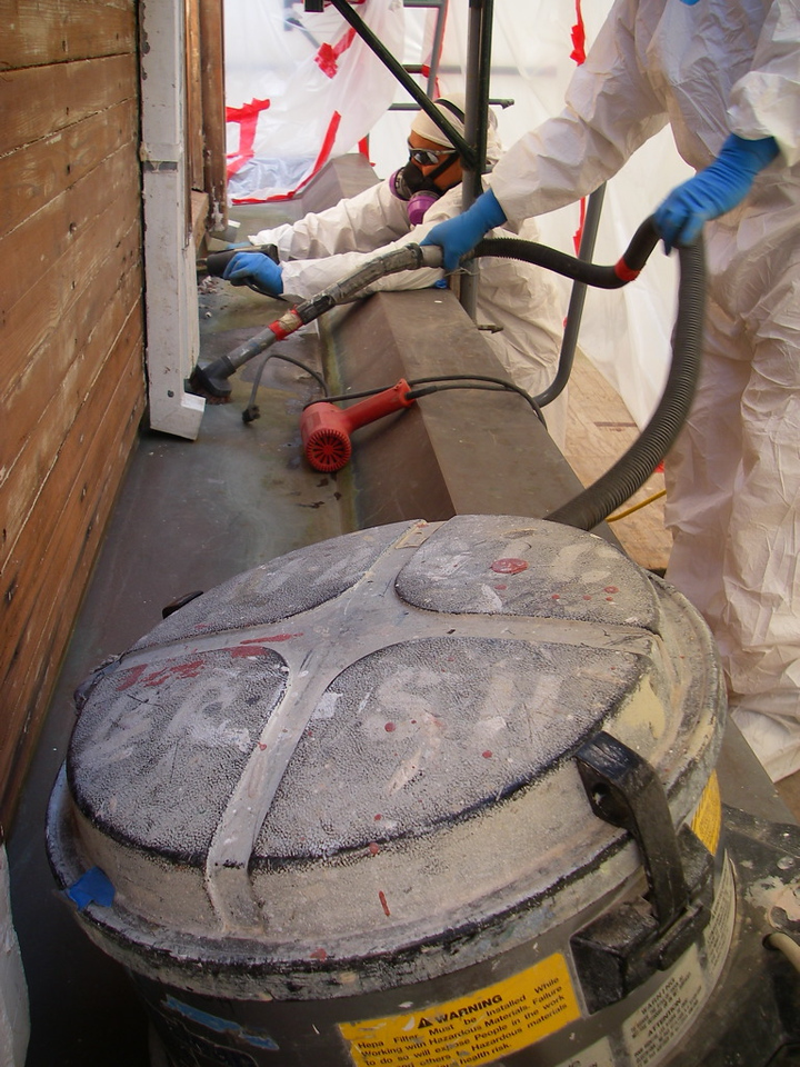 Stripping and cleaning old paint that contains lead. HEPA vacuum, HEPA respirators, etc.