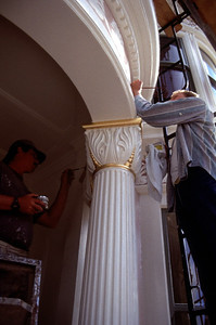 Putting the finishing touches on a restored facade.