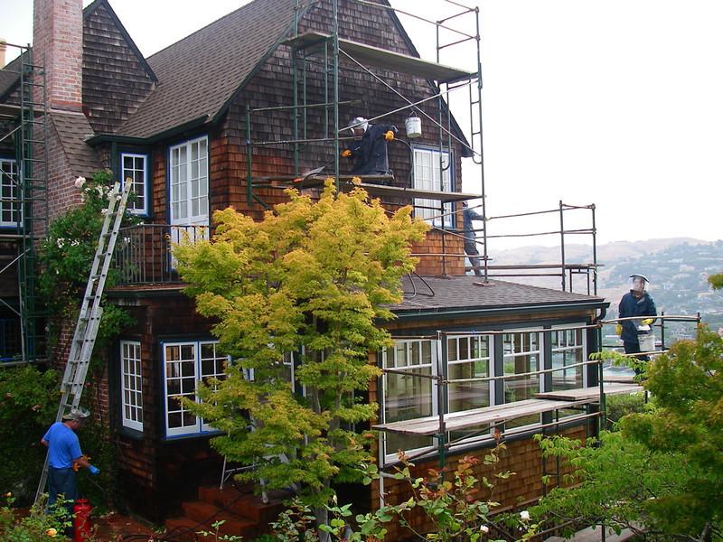 Tiburon home. Restoration of cedar shakes and painting trim. In progress photo.