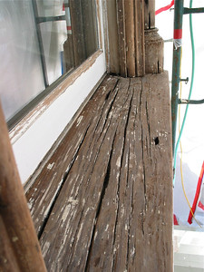 Window sill after stripping. Punky wood in grooves has been removed.
