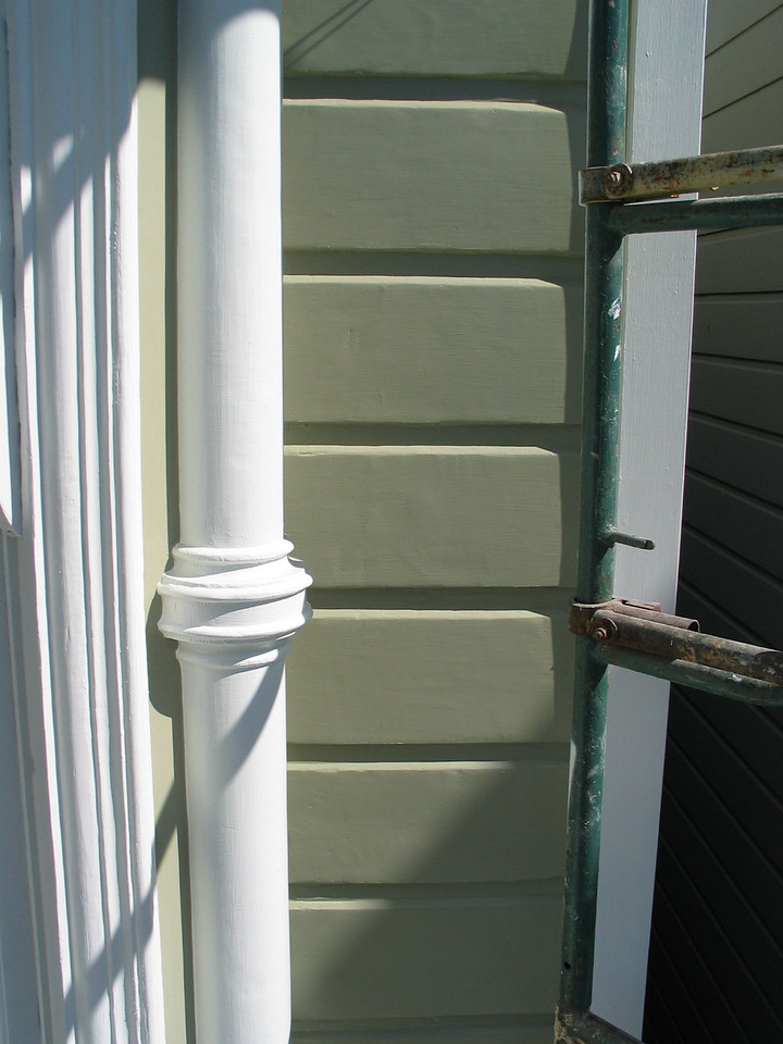 Same area after finish coating. Virtually the entire facade received a minimum of 5 coats - 1 coat sealer, 2 coats primer, followed by 2 coats of finish. The primer and the finish are acrylic latex.