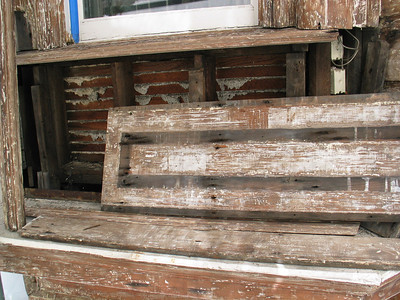 """Not much separating the inside from the outside. The plaster """"keys"""" of the interior wall can be seen with the lathe once the exterior panel has been removed."""