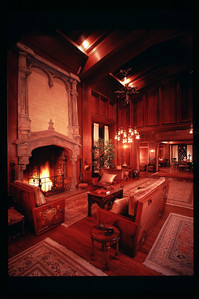 "Designed by Bernard Maybeck for the Roos family (and still occupied by the Roos family). Furniture is also original and designed by Maybeck. We restored the redwood (which covers the entire room, walls and ceilings). We also repaired and ""faux finished"" the fireplace to help it look like it originally did (smoke stained, of course), and repaired the horsehair and plaster chandeliers."