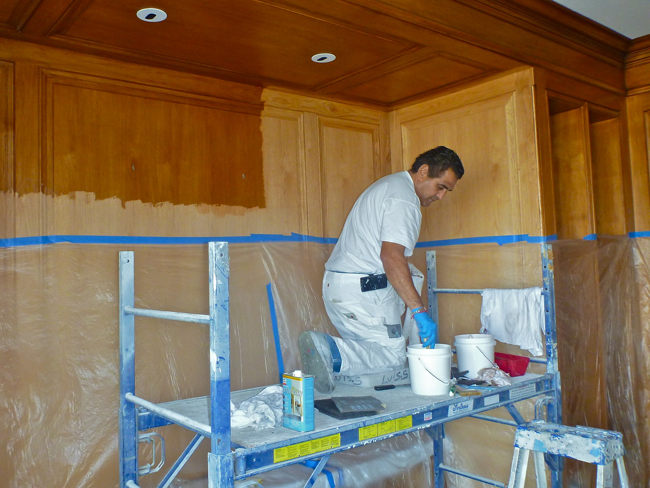 """Pacific Avenue Residence, pecan Library panelling, stripping in progress using """"green"""" stripper (non-methalyne chloride)."""