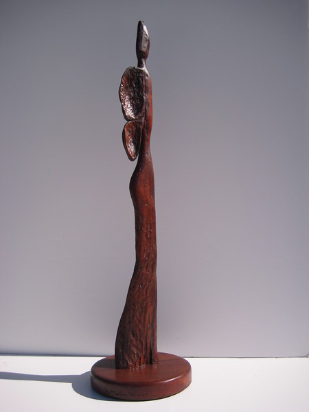 SHAPE SHIFTER SERIES ~ BUTTERFLY WOMAN<br /> Hawaiian Koa    right side<br /> H 22.5 x W 6 x L 6<br /> $695.<br /> woman becoming butterfly is about spiritual transformation