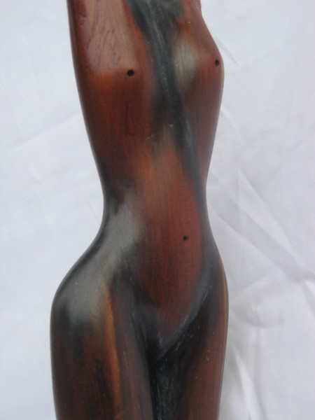 Moon Phases No 1 ~ Promise of the New Moon<br /> Red Cedar     detail right front torso<br /> 2012<br /> $795<br /> SOLD!<br /> twisting of torso implies movement and<br /> feeling of life force = good sculpture!