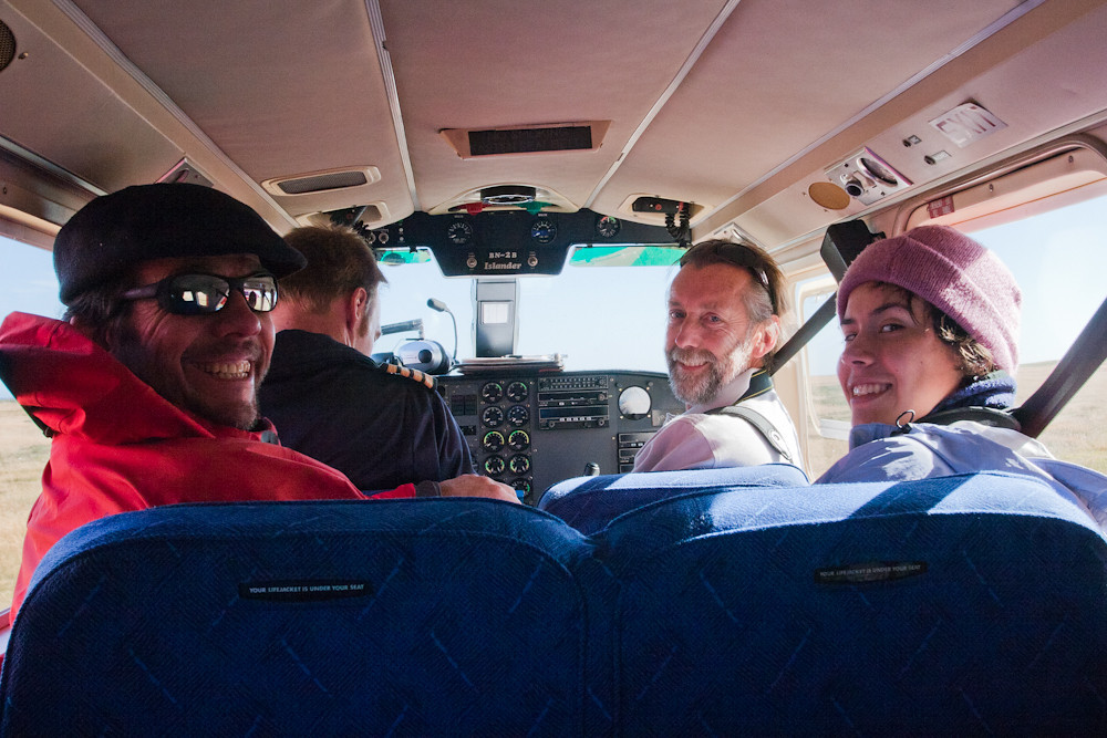 Guests Rodrigo Jordan, Carlos Tampier and Natalia Jordan during the short flight betweeb Carcass to Sea Lion Islands, Falkland Islands / Islas Malvinas