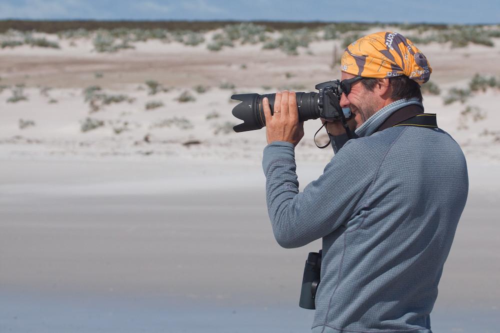 Our guest Rodrigo Jordan photographying King Penguins at Volunteer Point, Falkland Islands / Islas Malvinas
