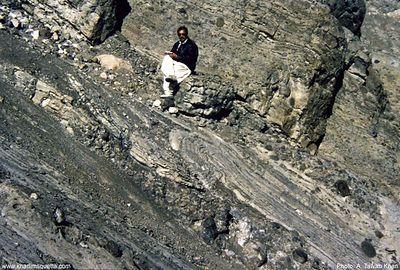Tawab Gul sitting on the deformed strata of Bibai Formation in Kach-Ziarat area.