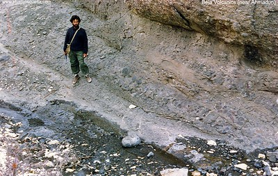 February 1990. I (Khadim Durrani) studying Bela volcanis. The location is near Ahmadun - off Quetta-Ziarat Road, almost midway between Quetta and Ziarat. The photo shows conglomeratic part of the Bela Volcanics.
