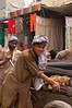 Pakistan, Lahore: Wheeling a cart through the 'second hand market'