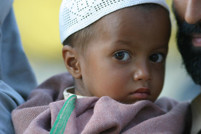 One of the children waiting to see the doctor at the field clinic.