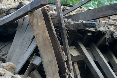Houses demolished by the Earthquake.  This is timber and mud construction.