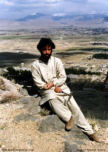 Relaxing and posing on the Muree-Brewery mountain (western Quetta). In the background over my head is the snow laden peak of Zarghun mountain (east-north-east of Quetta. This picture was taken in March/April 1990 by Thiery Aubry - a visiting Post-Doc student of geology from France.