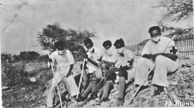 Rescue & search Volunteers wearing handkerchiefs in order to protect against the stench of death (Photo courtesy of J. E. Brown