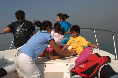 Kiran trying to keep the kids from flying off.