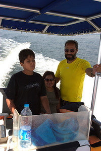 Sabir tries his hand at driving the boat.