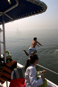 Sabir jumping into the ocean.