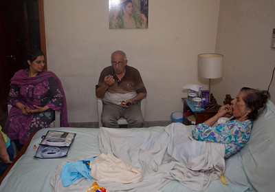 Uncle Farooq visiting with Mummy.  This was the first day I ws back and she was able to eat in bed and walk with support.  The following day she could barely move and would not eat.