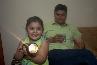 Zainab, freshly full of chocolates tried to figure out the flashlight.