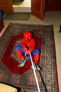 Clever Asad...I mean Spiderman got a length of elasticand tied it to the banister for his web.