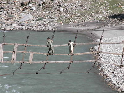 How to cross an icy cold fast flowing glacial river in Pakistan.