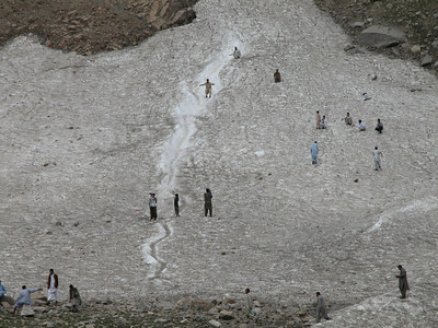Who needs skis? Sliding down the remains of a glacier near Lake Saif-Ul-Malook, Pakistan.