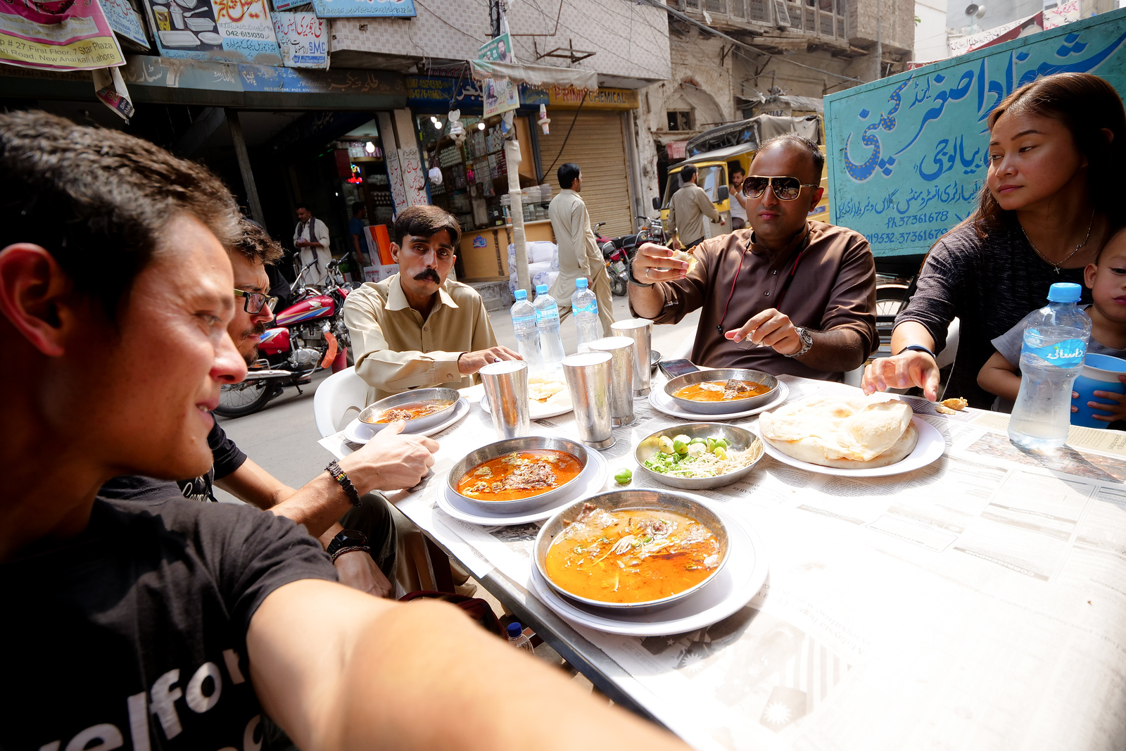 Eating Nihari on Stainless Steel tables in Lahore