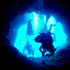 Exiting the cavern through one of the two holes that lead to a dive along the reef wall (that extends to the Blue Corner).