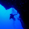 Looking out of the cavern from its largest exit point to the vertical reef wall.  On this dive, we entered the cavern through this hole because high surf precluded a reef top entry.