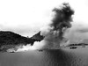 This photo shows smoke rising from the Japanese naval base at Dublon Island, an island that I boated past almost every day to get to the wrecks we were diving. Over 50 Japanese warships lay on the bottom of the lagoon and why us lovers of shipwrecks come here.