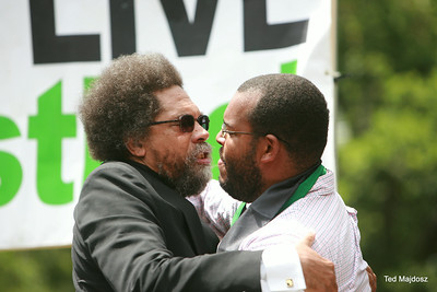 Dr. Cornel West embracing Eugene Puryear of Answer Coalition.