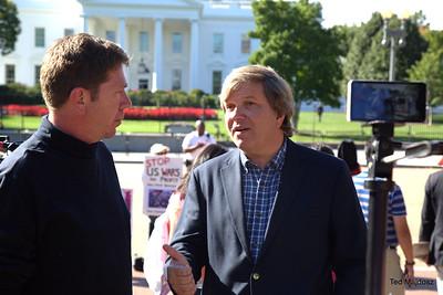 Rob Brune of D.C. Media Group interviewing Fr. John Dear.