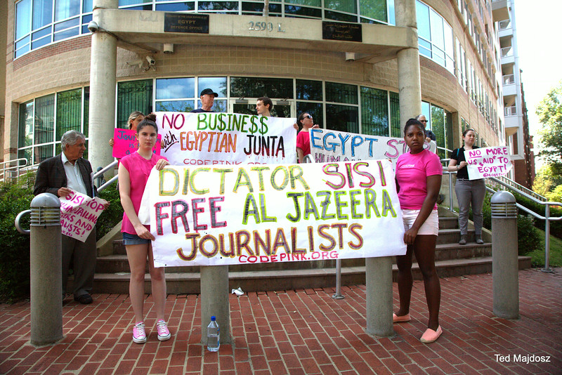 Code Pink and friends gather to protest what is happening in Egypt.