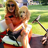 Gal pals forever: Coco loves her Red Sox golf cart, in which she drove Ms. Dacey around the golf course. She was extra-cautious so she wouldn't be picked up by Chelmsford's finest CPAL, who she loves and is always so excited to smooch, hug and lick! I'm dressed in traditional golf attire, wearing a rust-and-black DKNY golf shirt and a ruffled black ANNIKA Cutter & Buck Golf Skirt.