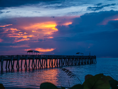 A cloudy sunrise over the Lake Worth Pier in Lake Worth on Friday, August 11, 2017. (Joseph Forzano / Deep Creek Images)