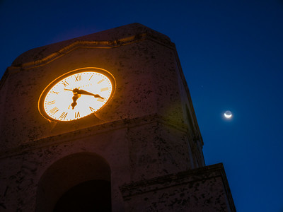 The crescent moon is visible behind the clock tower on Midtown Beach in Palm Beach on Thursday, August 17, 2017. (Joseph Forzano / Deep Creek Images)