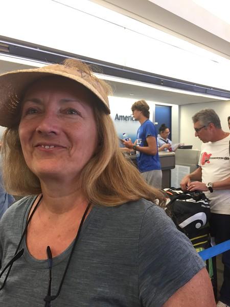 Sasha Zverev at the airport, behind me at desk.