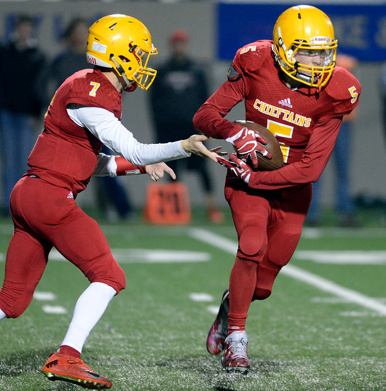 . Palma quarterback Zach Flores hands off to 5 against Campolindo during the Northern California Division 4 AA championship football game at Rabobank Stadium in Salinas on Friday December 9, 2016. (David Royal - Monterey Herald)