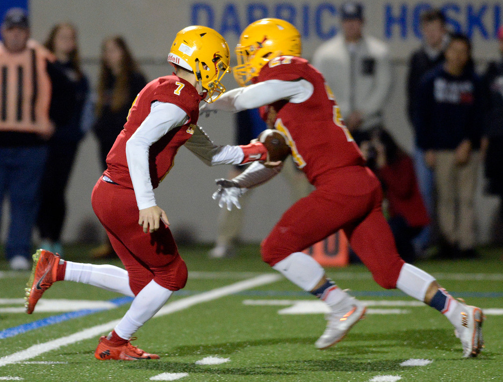 . Palma quarterback Zach Flores hands off to Emilio Martinez on the way to a 87 yard touchdown against Campolindo during the Northern California Division 4 AA championship football game at Rabobank Stadium in Salinas on Friday December 9, 2016. (David Royal - Monterey Herald)