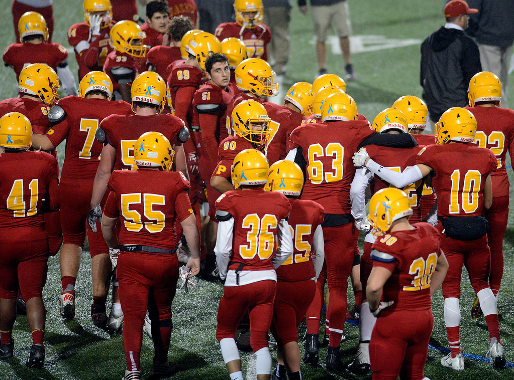 . Palma players gather together after their loss against Campolindo during the Northern California Division 4 AA championship football game at Rabobank Stadium in Salinas on Friday December 9, 2016. (David Royal - Monterey Herald)